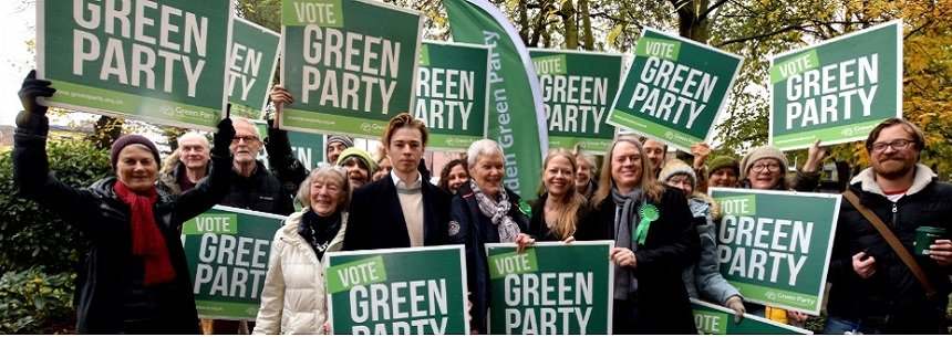 Camden Green Party Members holding banners in the park
